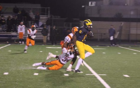 Football falls in first round blowout