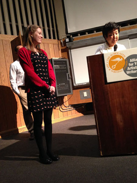 WRITE ON: At the Scholastic Art and Writing Awards ceremony for Chicago, senior Carolyn Kelly is called to the stage by Director Dr. Barbara Kato. Aside from her national Gold Medal, Kelly was awarded three regional Gold Key awards and one regional Silver Key award for her work.