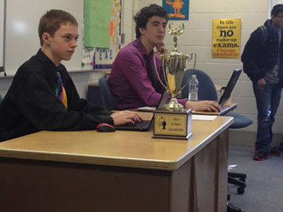 TITANS TAKE TREVIANS: Listening to judges explain their decisions in the final debate of the junior varsity State debate tournament, sophomore partners Brian Roche (left) and Michael Callahan (right) take notes to improve for future debates. Roche and Callahan defeated a partnership from new Trier to win the championship.