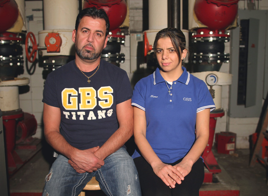 CONTEMPLATING THE CONFLICT: Despite living miles away from the heart of the Syrian conflict, GBS custodians Sahar Barkho and her husband Stewart Adam are affected just the same by the issue through familial connection in the country. The Assyrian population (symbol below) represents the minority of Christians in northern Syria, Iraq, Turkey and western Iran.