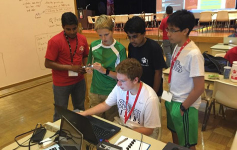 BRO CODE: Collaborating in website creation, freshmen Nicholas Ermolov, Ahmed Malik, Jesus Crespo and Matt Moran (seated) receive instruction from a coding expert. The boys coded for a full 24 hours and learned valuable skills along the way.  Photo courtesy of Mike Sinde