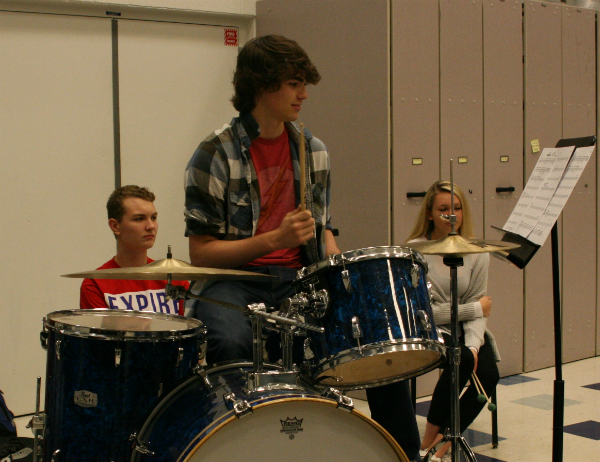 Tapping in time, Sholty drums with the rest of the jazz ensemble. Sholty performs in drumline, jazz band, and for IMEA.