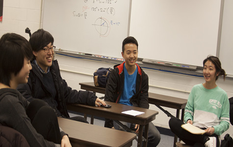 CELEBRATING CHRISTIANITY: Senior H2O members Kevin Jeon (left) and Claudia Choi (right) engage in a conversation with junior member Paul Choi (middle). The club discusses their faith and promotes positive fellowhip within the school. Photo by Jacqueline DeWitt