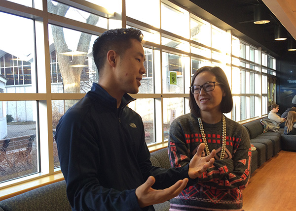 REDEFINING SERVICE: Wrapping up a Key Club meeting, club sponsor Josh Koo (left) talks to student teacher Stephanie Jund about the club's agenda. Aside from his many roles at South, Koo extends his reach deep into the city to aid organizations in need by creating documentaries aimed at raising awareness or funds for various causes.