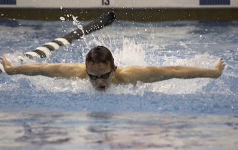 FLYING FORWARD: Looking towards the wall, senior Peter Dales takes a quick breath during his 100-yard butterfly against Niles West on Jan. 22. Dales swam the 100-yard butterfly in 59.77 seconds, coming in second place behind Niles West's Adam Orynczak.