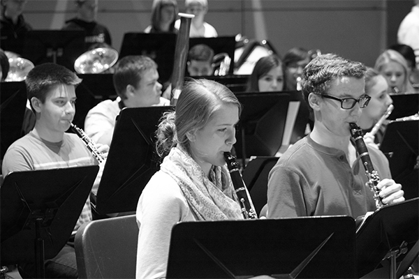 VACATION PREPARATION: Rehearsing various pieces of music, sophomore Erin Kirby and senior Marc Turenne play the clarinet to help the band determine which to perform in Hawaii. The band holds special rehearsals in order to prepare for their performance.
