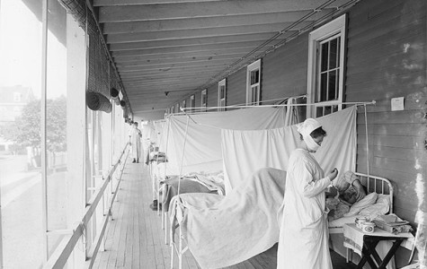 PANDEMIC PATIENTS: Aiding a patient at Walter Reed Hospital in Washington D.C., a nurse helps combat the influenza pandemic of 1918.  Photo from Wikimedia Commons