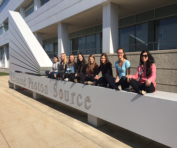 Women at Work: Six juniors along with science teachers Jill Serling and Lisa Pavic sit outside the Advanced Photon Source building of the Argon National Laborarory on April 14. The women attended a conference that encourages women to get involved in STEM fields and gives aspiring scientists a look into the real world of science.