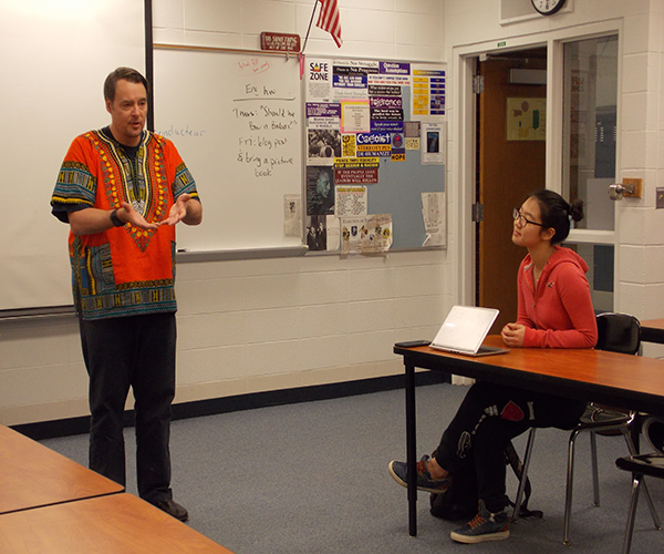 WHIPPLE'S WISE WORDS: Speaking to his AP World class, Matthew Whipple leads a dicussion that includes a balance of current events and topics outlined in the world history curriculum. Whipple takes many of the themes from this class and applies them to STAND For Peace (STAND), the international service club that he has sponsored for over 10 years.