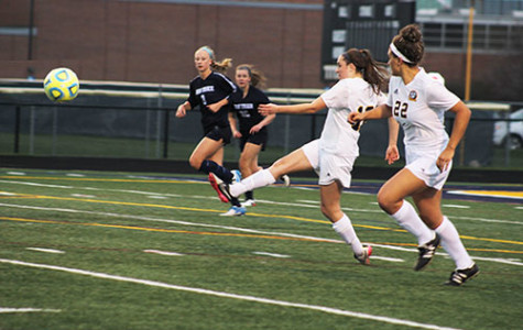 KICKING AND SCREAMING: Following through on a kick, junior Callie Pekosh launches a ball down field during a game against New Trier on April 19. The Titans tied New Trier by a score of 1-1.