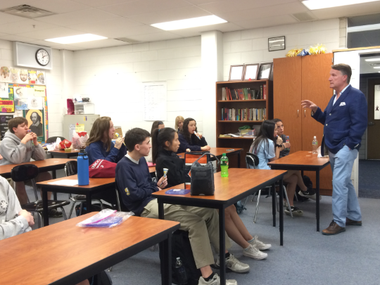 SERVICE WITH SHELLARD: Speaking to a class of Sophomore Honors English students, Dr. Jim Shellard, assistant principal of student activities, emphasizes the importance of serving others. Shellardís remarks set forth the celebration of the service research projects.