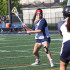SHOOTING FOR SUCCESS: Progressing through her shot, senior captain Sarah McDonagh practices her form during a scrimmage before the playoffs. The Titans won their first playoff game against Barrington by a score of 16-4 on May 18.