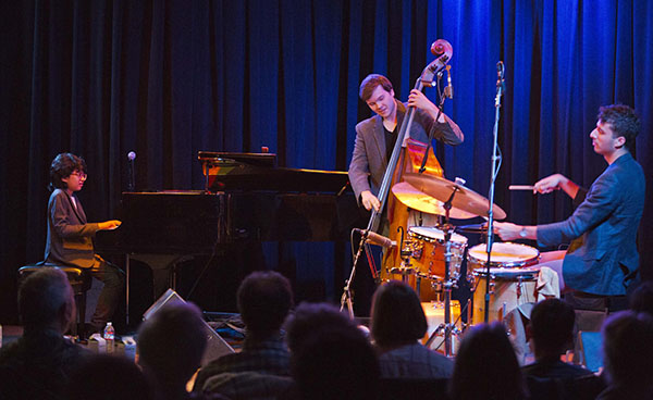 "BASS BOY: Strumming the strings on his bass, South alumnus Dan Chmielinski performs alongside his bandmates in their group entitled ""The Joey Alexander trio."" The trio performed at Kuumbwa Jazz, a concert venue in Santa Cruz, California."
