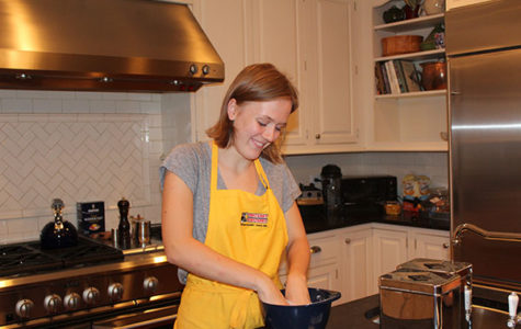 KATE'S  KITCHEN:  Kneading the dough for buttermilk biscuits, junior Kate Voss prepares a classic dinnertime staple in her kitchen at home. Voss has been involved in the culinary program at South since her freshman year, and also runs her own catering business, called 'Katering', outside of her involvement at school