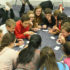 Breaking   the     Ice:  Huddling in a circle, South freshmen and their senior Peer Group leaders gather together during their designated Peer Group block. As a group, they work to form new friendships through teambuilding and get-to-know you games.
