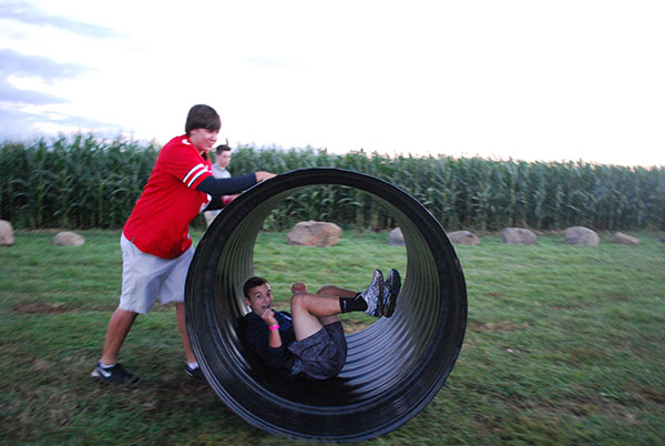 LET THE GOOD TIMES ROLL: Being pushed by junior Sam Dale, junior Michael Heftman enjoys an attraction at the Richardson Corn Maze. This activity was an option available to students who attended this Students For Students event on Sept. 10.