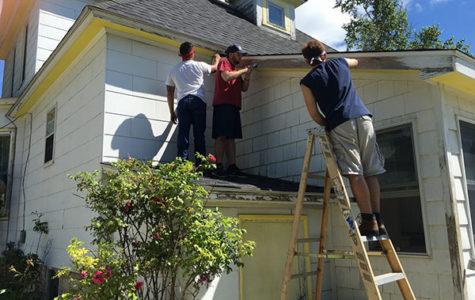 Painting a needy family's house, Zach Cepeda, Harrison Kane and Reggie Lara take part in Habitat for Humanity. The program helps adults and kids build and refurbish houses for people in poverty.   Photo courtesy of Zach Cepeda