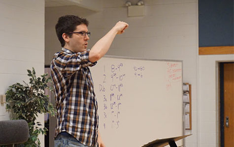 Enlightened by Ermel: Daniel Ermel, new co-choir director, teaches Glee choir class. His goal for students is for them to grow as musicians by looking further into the music they perform.