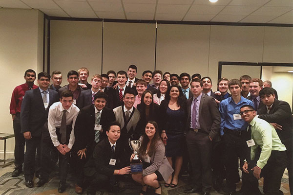 Titans with trophies:  After a victory, South's former 2015-2016 BPA team poses at the BPA State Competition held in Oakbrook, Illinois during March of 2016. The trophy, referred to as the Professional Cup, was won by South's BPA team for being the most outstanding BPA chapter in Illinois. Photo courtesy of Rosie McManamon