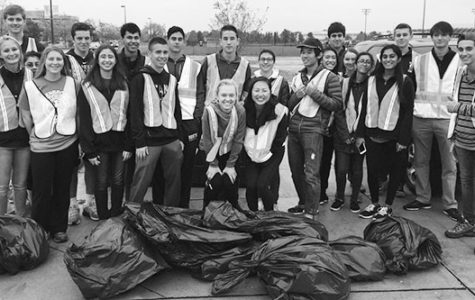 CLEANUP CREW: Posing with bags of trash, Interact members proudly display their success in cleaning a portion of Landwehr road. Interact and other clubs at South have planned several environmental awareness-based service projects. Photo courtesy of Lily Sands
