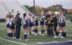 Women's sports teams develop support system with big and little sister programs