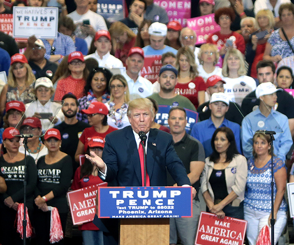 Election emotions: Rallying amongst a crowd of his supporters (right), president-elect Trump speaks at a pro-Trump event in Phoenix, Arizona. Trump was elected President early in the morning of Nov. 9, 2016.