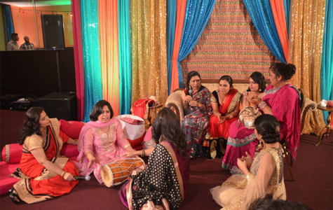 Cultural customs: Celebrating a cousin's wedding, the Kalra family women take part in the tradition of singing songs that welcome the groom into the family and send off the bride into a happy marriage. This generallly occurs on the second night of the wedding, which can last up to a week. Photo courtesy of  Anushka Kalra