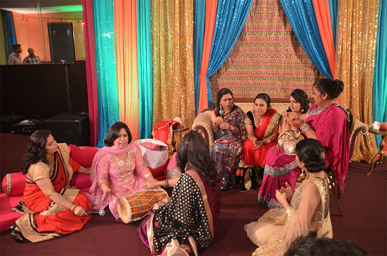 %0ACultural+customs%3A+Celebrating+a+cousin%E2%80%99s+wedding%2C+the+Kalra+family+women+take+part+in+the+tradition+of+singing+songs+that+welcome+the+groom+into+the+family+and+send+off+the+bride+into+a+happy+marriage.+This+generallly+occurs+on+the+second+night+of+the+wedding%2C+which+can+last+up+to+a+week.+Photo+courtesy+of++Anushka+Kalra