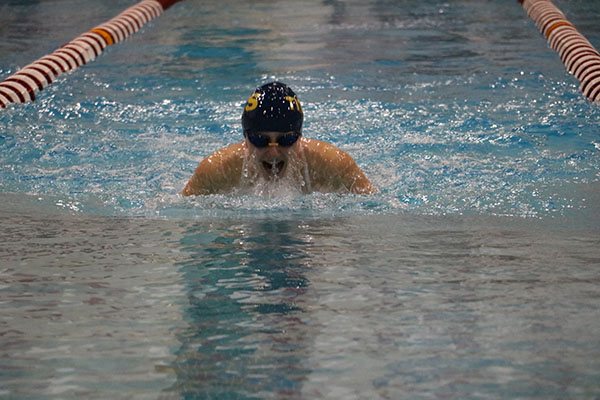RULE THE POOL: Lunging forward, senior Maddie McMillin swims the 100 yard breast stroke during the Niles West Dual Meet on Oct. 21.