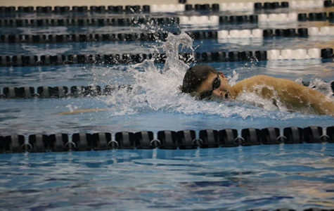 MAKING  A   SPLASH:  Quickly breathing, senior swimmer Sam Iida  races the clock in the 200 yard freestyle where he broke the pool record with a time of 1:39.97.