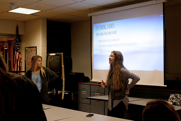 Presenting to club members, Sophie Hensley and Chloe McKerr discuss upcoming yoga related events.  Club Younity strives to bring spiritual awareness to the South student body.