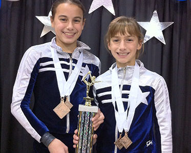 Hartley sisters continue to inspire each other in gymnastics