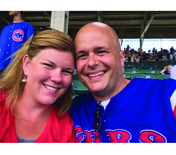Smiling at the camera, GBS teachers Steve and Kara Bolf attend a Chicago Cubs game. There are several teachers who are married to their coworkers at South. Photo courtesy of Steve Bolf