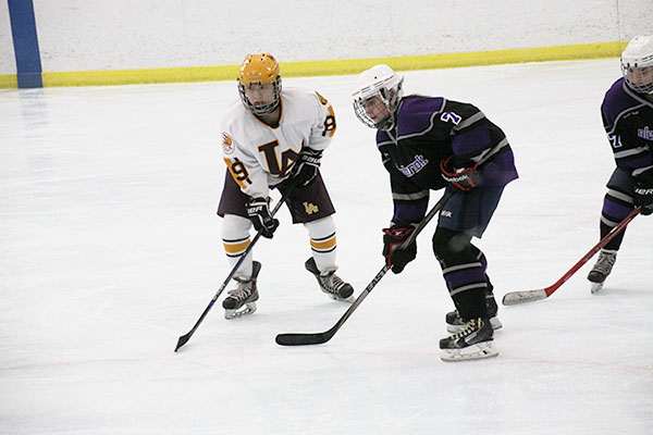 icy hot: Preparing to receive a pass from a teammate, GBS sophomore Shannon Schmitt looks to make a break away and score against Loyola during a game on Jan. 29 at the Northbrook Ice Arena. The team went on to play two more games against Loyola.