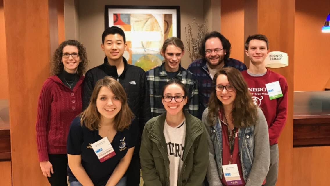 Performers in Peoria: Kristin Meyer and Aaron Kaplan, GSO co-conductors, pose for a picture with ILMEA state finalists Ellis Cho, Jack Sundstrom, Jack Kelly (top), Kayleigh Markulis, Andrea Radaios and Emma Brooks (bottom) at the ILMEA state festival. The festival took place from Jan. 26-28 in Peoria.