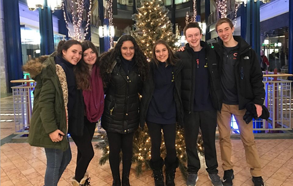 Argumentative Achievements: Standing in their hotel lobby, JV debaters Sabina Roberts, Katie Kenner, Alysa Aralis, Kelly Skoulikaris, Michael Scott and Dylan Goldberg pose for a photo at the John Edie Holiday Debates tournament in Minnesota (Left). Debate Coach Jon Voss said the JV teamís willingness to work together helped them find success at their state competition.