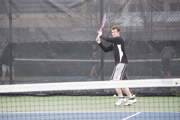 Facing his doubles partner,                                 captain Sebastian DesRoberts                               works on his forehand. DesRoberts and Gupta hope to do well at State.