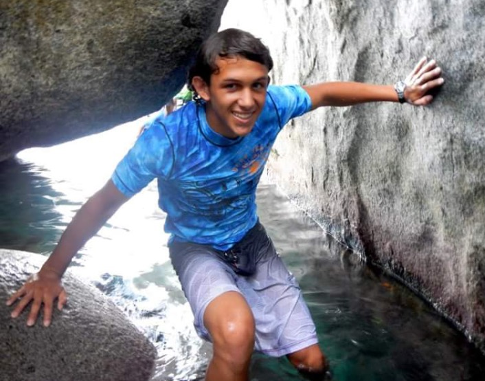 GEOLOGY GURU: Exploring a cavern in Baths National Park, senior Max Klemm learns about biology and geology in a two week summer camp. Klemm is one of many seniors who will use the summer to study their soon-to-be college major. Photo courtesy of Max Klemm