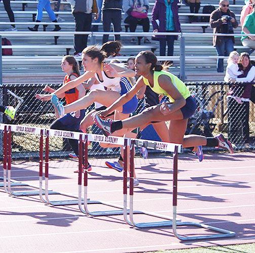 HURDLE HERO:  Jumping over a hurdle, Junior Bailey Smith, competed in the IHSA Sectionals at Loyola Academy on May 11. Smith competed in State last weekend and placed 20th in the 100 meter hurdle with a time of 17.47.
