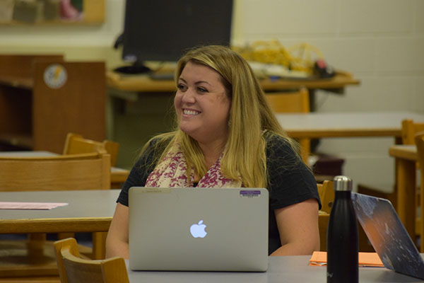 Bright Beckwith: Smiling in approval of the work of the GBS Model UN delegates, Nyssa Beckwith, social studies teacher, supervises the meeting's activity.  Beckwith is the new adviser to the club after Terrence Jozwik retired last year.