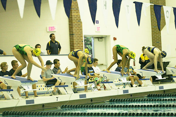 MIGHTY MARKS:  Taking their marks, the girls swim team gets ready to dive into the pool against GBN on Sept. 16. The Titans defeated the Spartans by a score of 123-63.