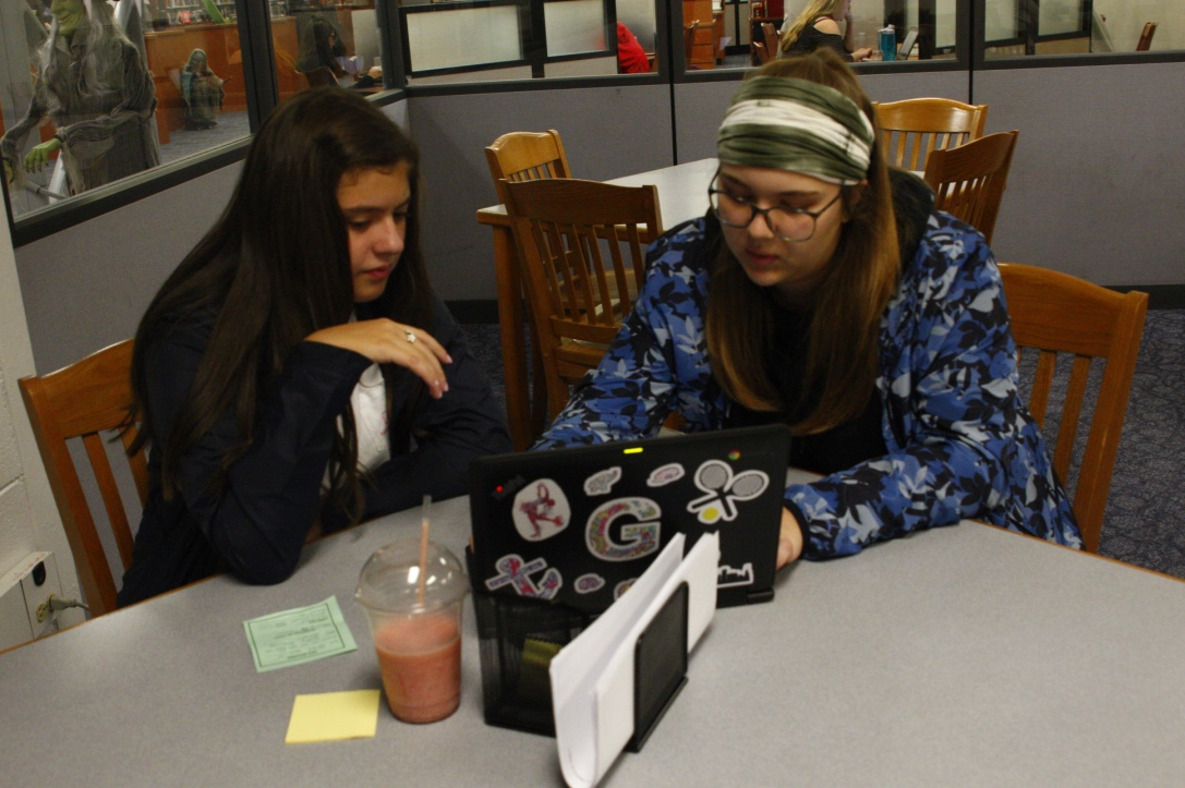 Student tutor helps a peer with their work in the TLC.