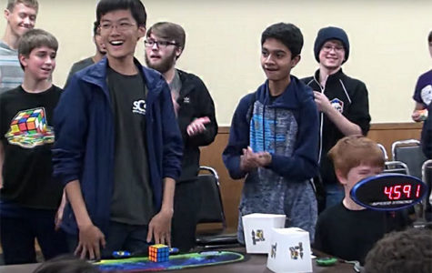 "SPEEDY STEVE: Standing up in amazement, senior Steve Cho smiles as he realizes he solved the 3x3 Rubik's Cube solve in 4.59 seconds at the 'ChicaGhosts 2017"" on Oct. 28. Cho has been cubing since 2012, and over the course of five years he has attended thirteen American Cube Association competitions. Photo courtesy of Steve Cho"
