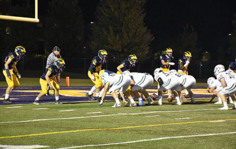 Turnaround Titans:  The Glenbrook South football team lines up for a play during their final regular season game against New Trier. The Titans fell to the Trevians 28-15, and went on to finish their season the following week against Barrington.