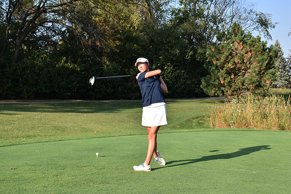 Taking a practice shot, senior Sophia Lau finishes her swing with a follow through. Lau competed with the rest of her team at state on Oct. 13 and 14.