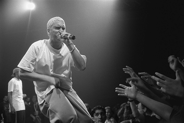 EMPHATIC EMINEM:  Hyping up his fans, Eminem performs at his 1999 tour in Munich, Germany. Eminem was a best-selling artist in the 2000s and recently released his newest album, Revival.