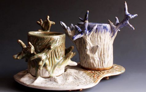 """TWISTING TREES:   Competing in the Illinois High School Art Exhibit, which took place on Feb. 25, junior Joanne Park's piece titled """"Variety and Repetition Tree Cups and Saucer"""" won first place in the ceramics division. This competition featured work from around 500 student artists within the state."""