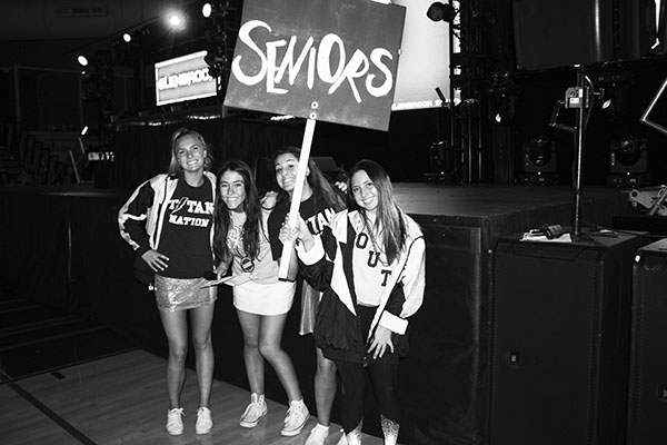 WINNIN' WOMEN: Smiling at the 2018 Pep Rally, seniors Cat Berg, Abby Grant, Gracie Hambourger and Bebe Haramaras show their spirit. The four senior girls make up South's first all-female executive board. Photo courtesy of Abby Grant