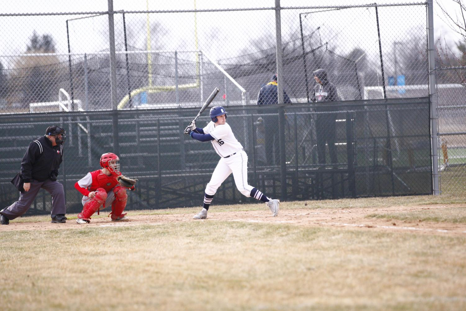 HITTIN' DINGERS:  Eyeing the pitch, senior Jacob Newman looks to connect with the ball against Deerfield. The Titans fell to the Warriors 15 to 4.