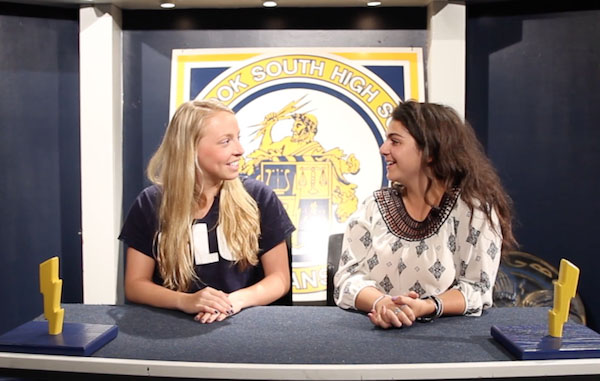 ATTENTIVE ANCHORS: Filming their episode of the Glenbrook South Report, Senior Guest Ellie Eimer and MariaElena Kouriabalis, senior film student, inform students and teachers of upcoming events around the school. The film students placed top three in nine of 16 categories at the Midwest Media Educators Association festival.